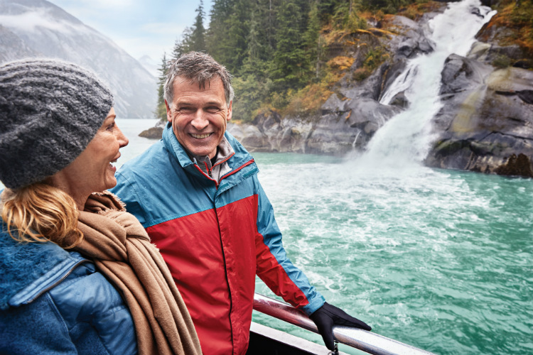 A couple enjoying a cruise in Tracy Arm Fjord in Alaska