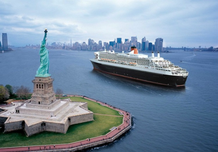 Cunard's Queen Mary 2 cruise ship sailing past the Statue of Liberty in New York
