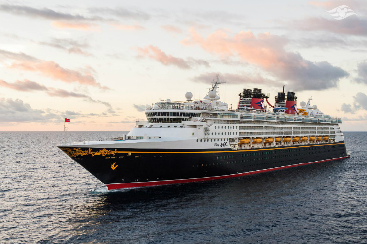 Exterior of the Disney Magic cruise ship as it sails across the ocean at sunrise