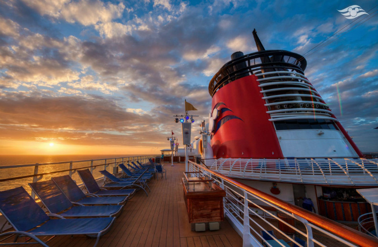 The top deck of a Disney Cruise Line ship at sunset