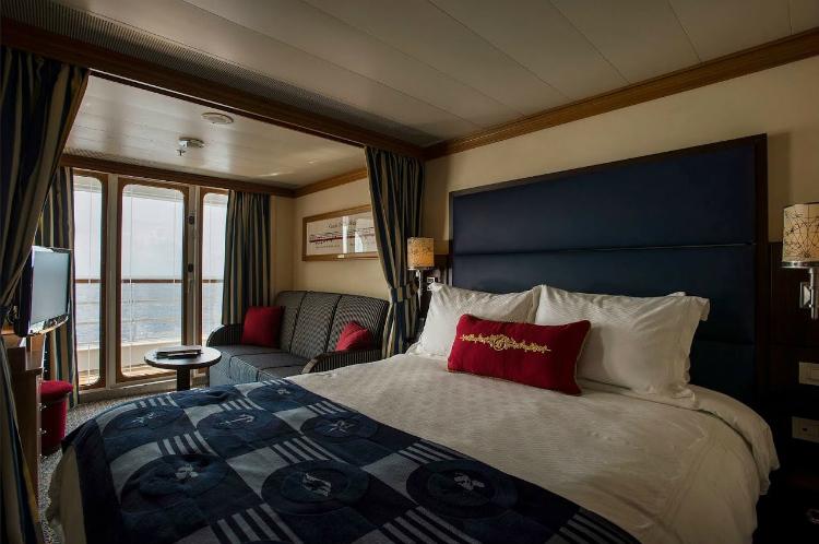 A family-friendly Verandah stateroom on-board Disney Dream