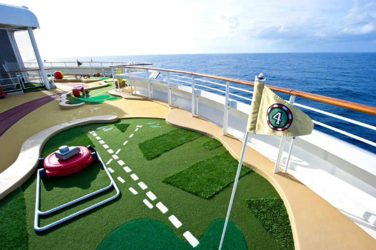 A mini golf course on a deck of the Disney Dream cruise ship