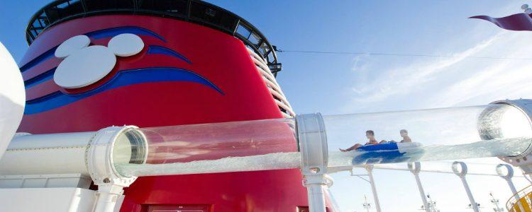 A guest whizzing down a waterslide on-board Disney Dream