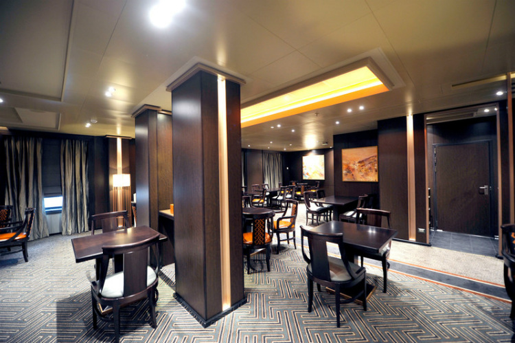 Chairs and tables in the sophisticated Sindhu restaurant on PO Britannia