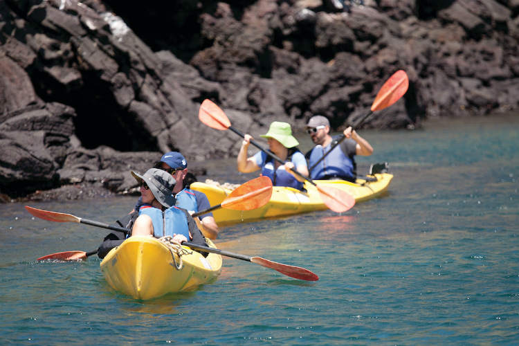 Silversea expedition cruise guests enjoying a kayak excursion in the Galapagos