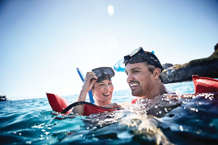 A couple snorkelling in the Caribbean sea with Princess Cruises