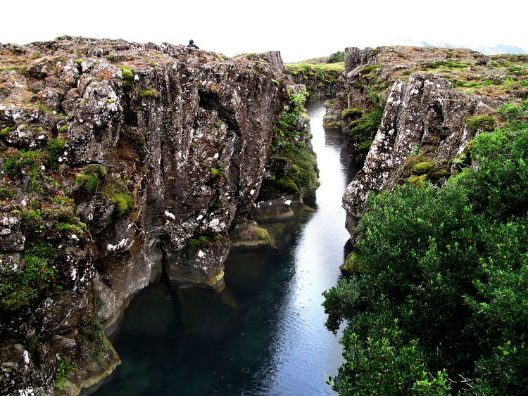 A channel of water created by shifting tectonic plates at Thingvellir National Park in Iceland
