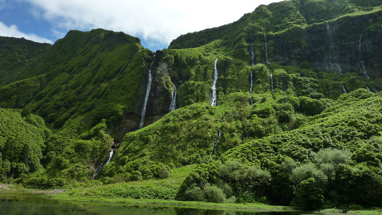 Waterfalls cascading down lush cliffs in the Azores
