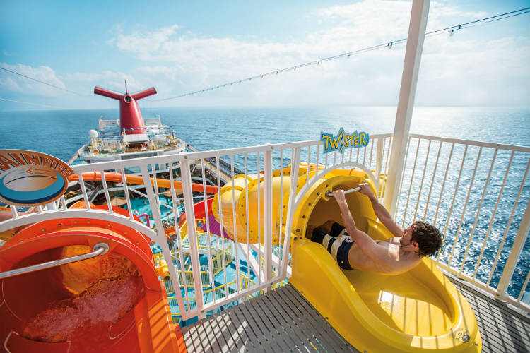 Boy about to slide down the Twister slide on-board Carnival cruises
