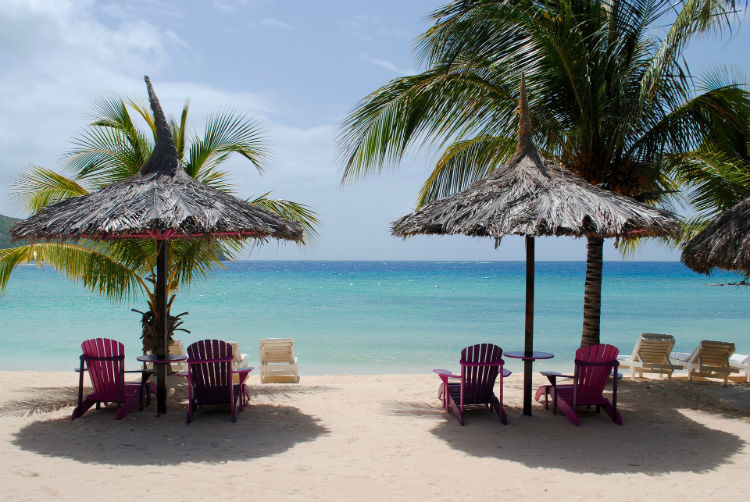 Chairs on the beach in the sun - Caribbean