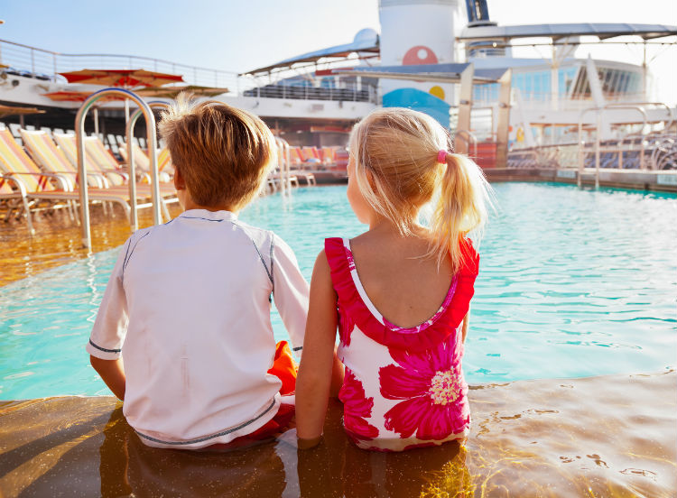 Kids sat poolside on-board Royal Caribbean