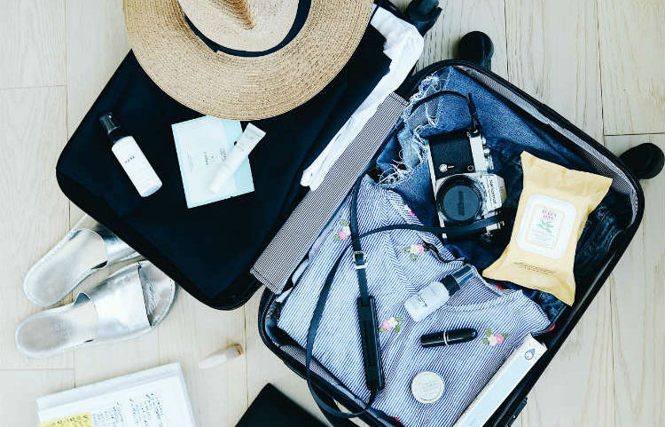 Open suitcase - packing for holiday