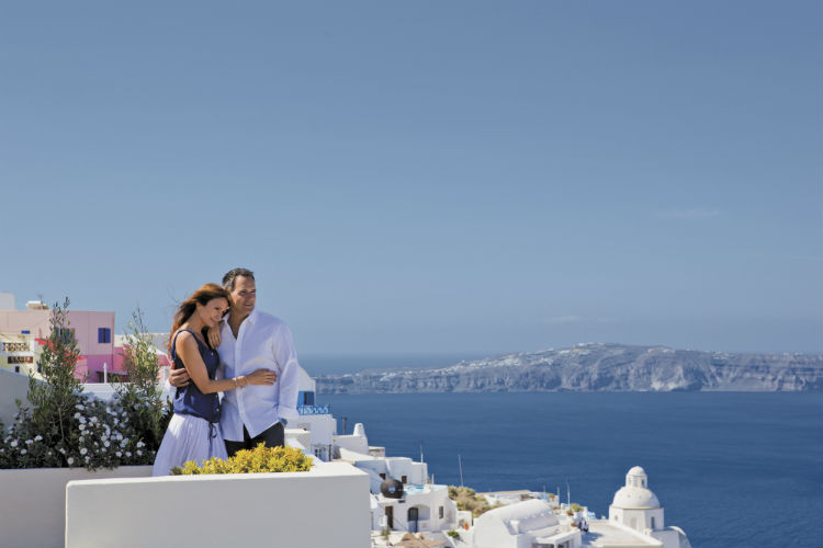 Couple on a balcony in Greece - Saga Cruises
