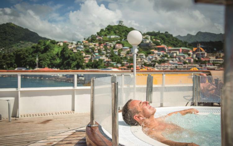 Fred. Olsen - Man relaxing in hot tub