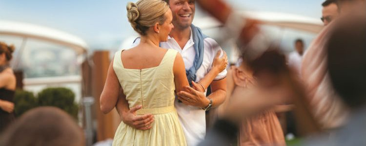 Couple dancing on-board Celebrity Cruises