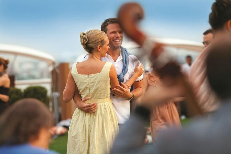Couple dancing on-board Celebrity Cruises