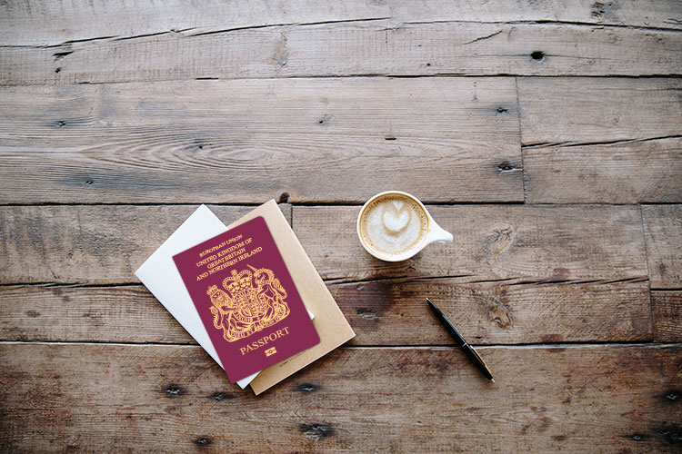 Passport on wooden table