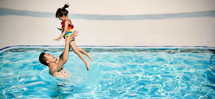 Father and daughter playing in the pool - Princess Cruises