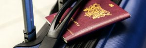 Passport and suitcase - Holiday packing