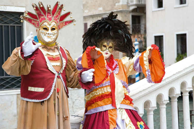 Two people in costume at Venice Carnival