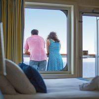 Couple on the balcony in the stateroom