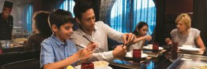 Family dining in Izumi on-board Royal Caribbean