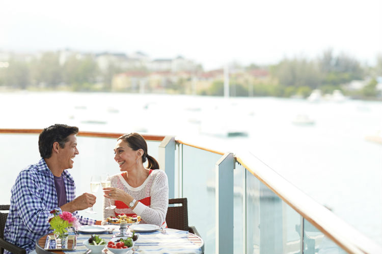 Couple on a balcony on-board Holland America