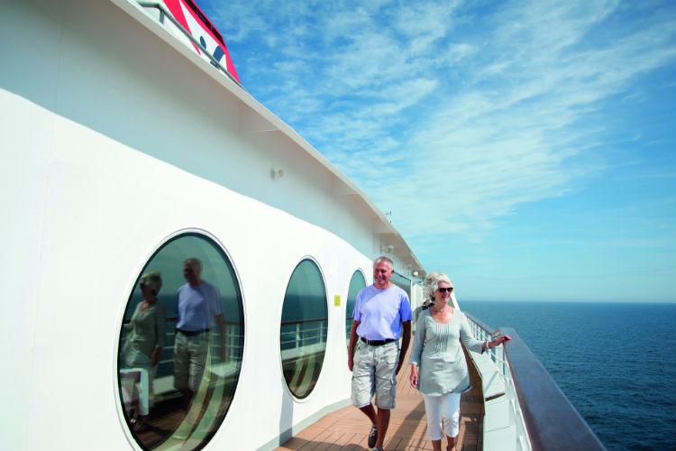 Couple on the promenade aboard Braemar - Fred Olsen
