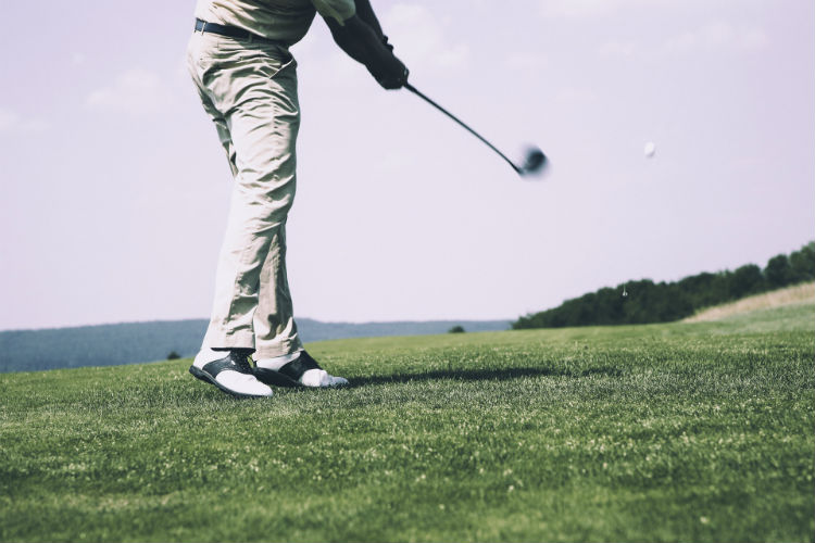 Man playing golf on a course