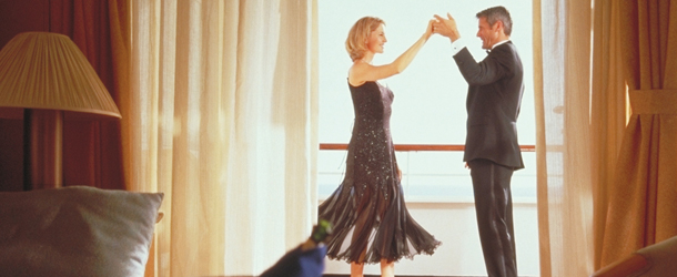 A couple dances on a Holland America ship balcony
