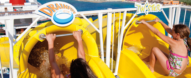 A family enjoys the water slides on a fun cruise