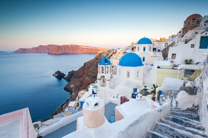 Oia, a Santorini village and Royal Caribbean cruise destination, at sunset