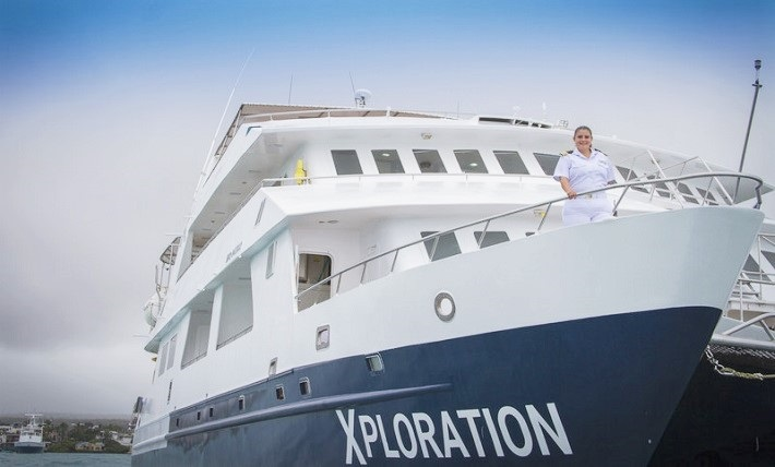 Captain Nathaly Alban standing on the deck of her ship, Celebrity Xploration