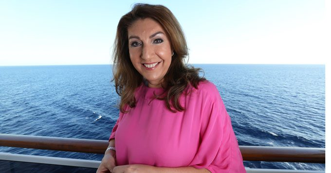 Jane McDonald posing for pictures on the balcony of a cruise ship