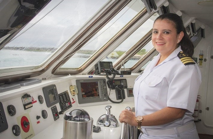 Captain Nathaly Alban at the helm of Celebrity Xploration as it cruises the Galapagos