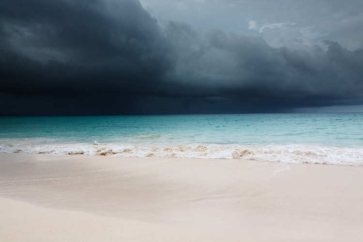 Stormy black skies heading towards a beach in the Caribbean
