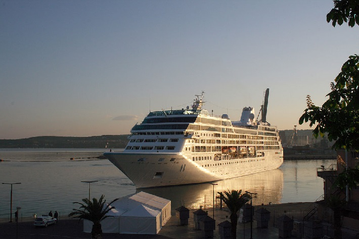 Azamara Pursuit in a Mediterranean cruise port at dusk