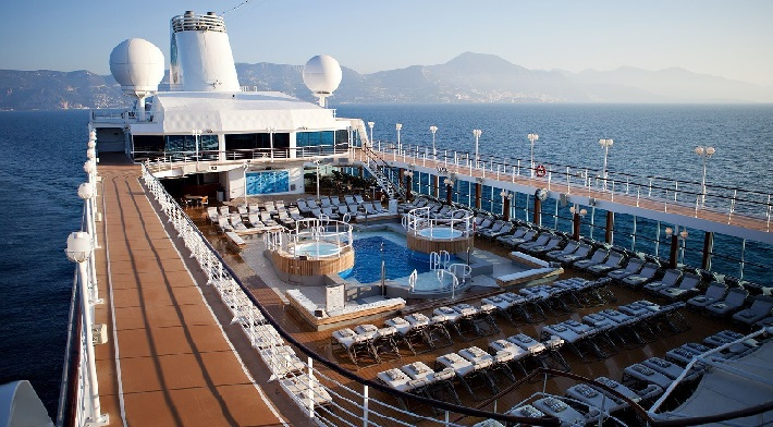 The pool and sun loungers of the top deck on-board Azamara Pursuit