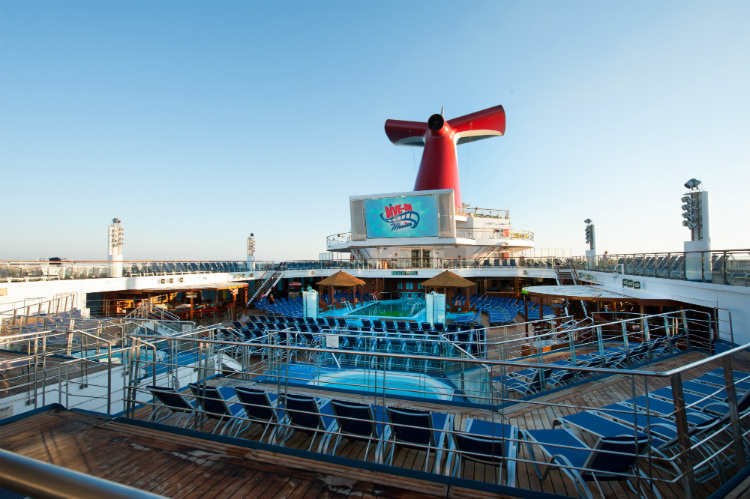 The pool deck on-board Carnival Horizon in the early morning sunshine