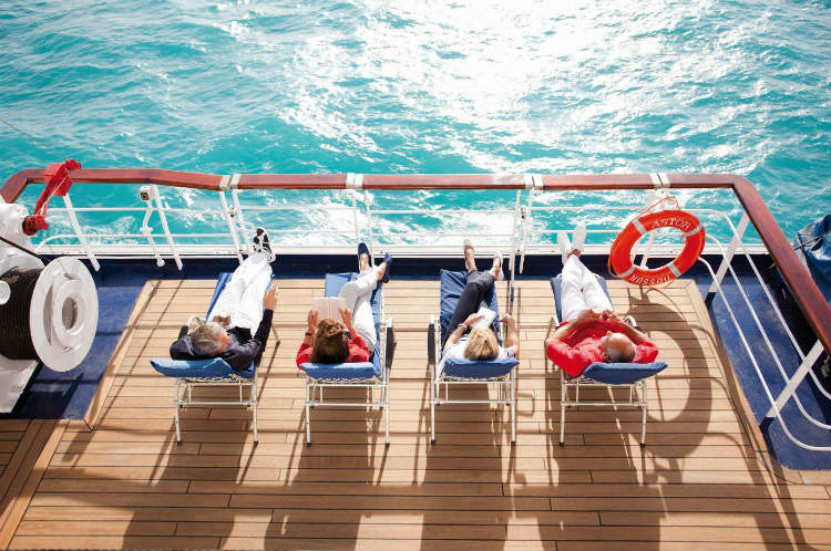 Guests sunbathing on-board CMV