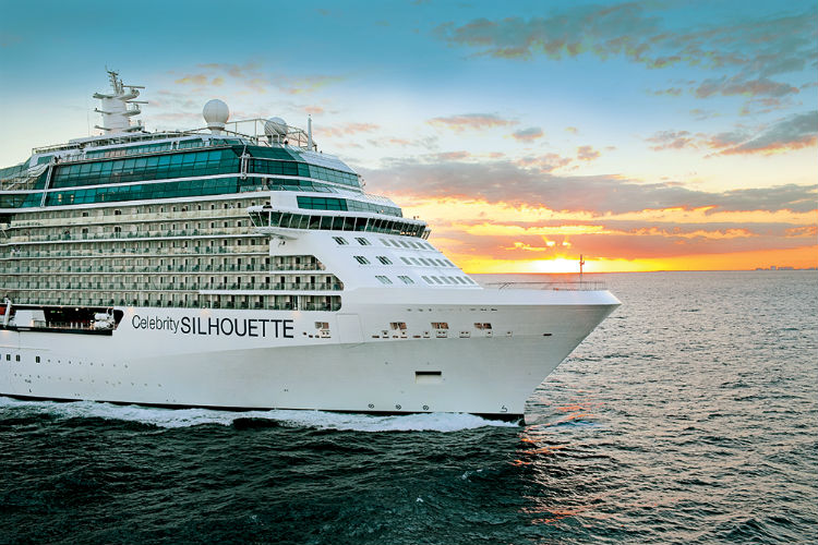 Celebrity Silhouette sailing with sunset background